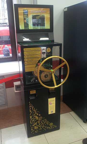автомат сувенирных жетонов